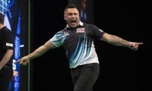 Darts star Gerwyn Price celebrating during a game