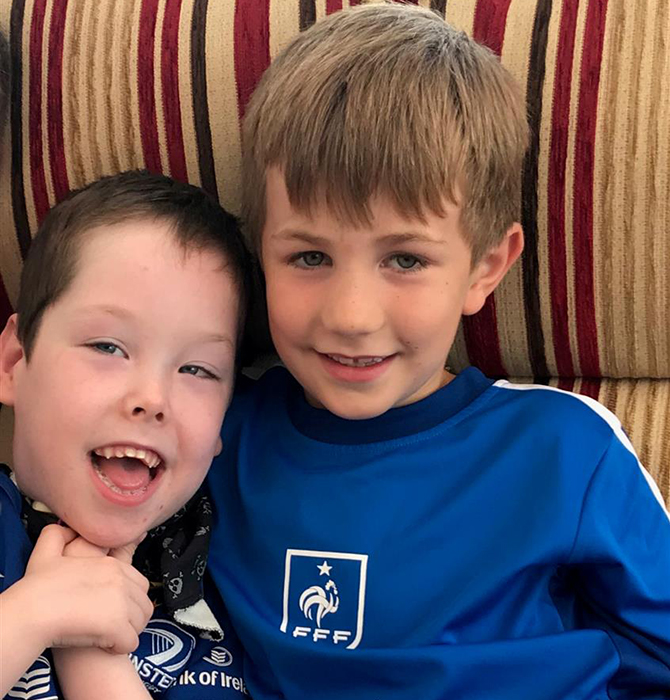 Oisín, right, completed the challenge in memory of his cousin Josh, left, who passed away last year
