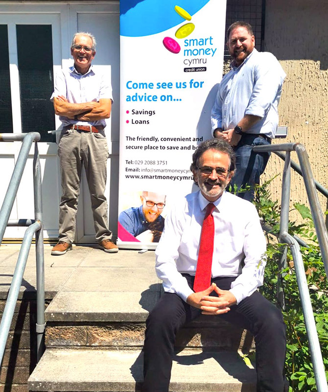 Smart Money Cymru chair Alun Taylor, front, Islwyn Credit Union director Martin Price, left, and Todd Rawson, chair of Islwyn Credit Union