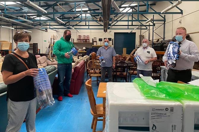 Dawn Bowden MS, left, with volunteers at Furniture Revival and Cllr Carl Cuss, right