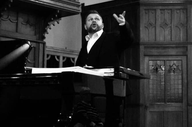 Tenor Lee David Bowen performing on stage