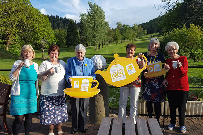 Members of the Caerphilly Fundraising Group celebrating the annual tea party, Picture taken before social distancing