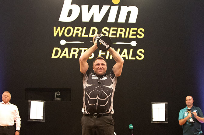Gerwyn Price lifts the World Series of Darts trophy in Salzburg, Austria