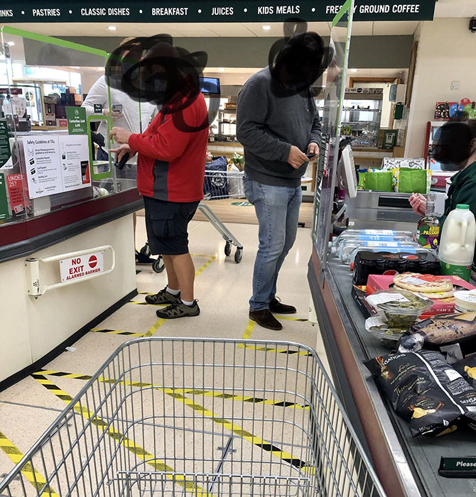 An image appearing to show a lack of social distancing at the checkouts at Morrisons Caerphilly
