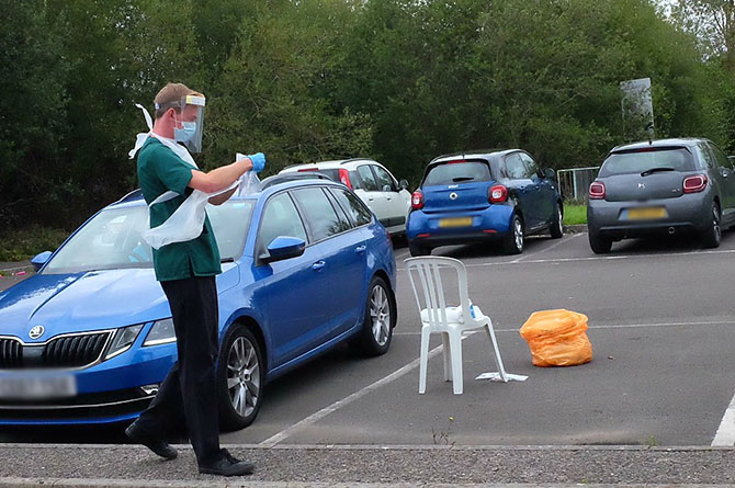 A coronavirus tester wearing full PPE at the test centre in Caerphilly