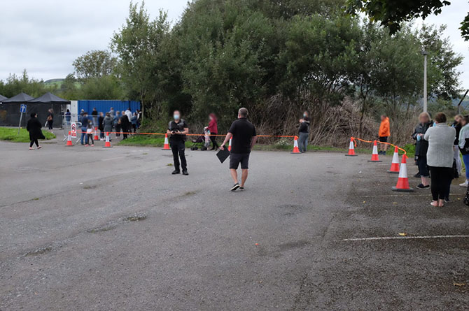 People queuing outside the coronavirus test centre at Caerphilly leisure centre