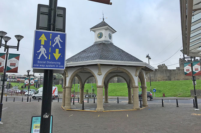 A social distancing sign near the bandstand in Caerphilly town centre