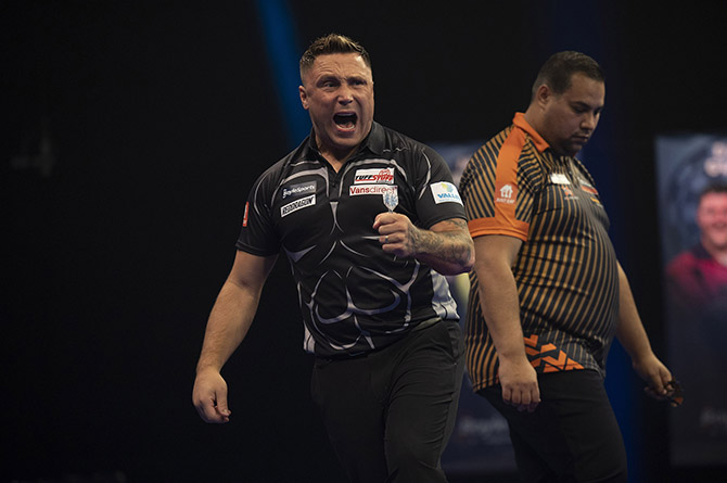 Gerwyn Price celebrates during his World Grand Prix clash with Jermaine Wattimena