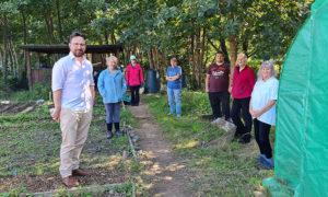 Volunteers at the Morgan Jones Park community allotments alongside Caerphilly MS Hefin David, left