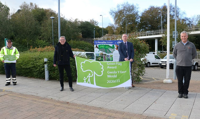 From left: council parks officer Andrew Dyer, Cllr John Ridgewell, council green spaces manager Mike Headington and parks officer Gareth Davies with the Green Flag award at the council's headquarters