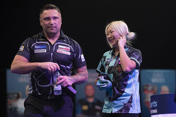 Gerwyn Price and Mikuru Suzuki during their Grand Slam of Darts clash