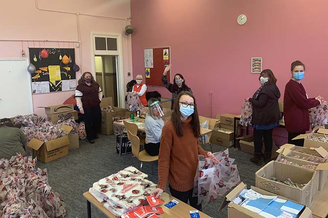Operation Santa 2020 volunteers wrapping gifts at Bedwas Workmen's Hall