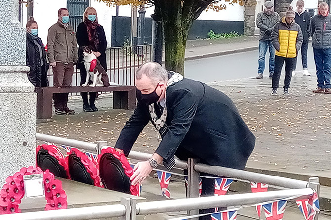 Caerphilly town mayor Mike Prew laying a wreath at the cenotaph