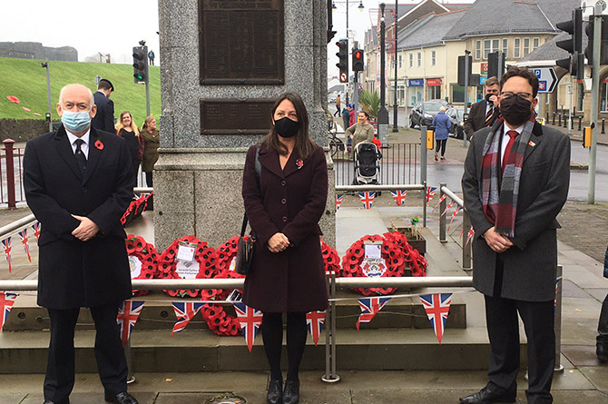 Caerphilly MP Wayne David, council leader Philippa Marsden and Caerphilly MS Hefin David at the cenotaph in Caerphilly town
