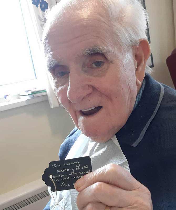Ty Iscoed resident Bernard with a Remembrance message