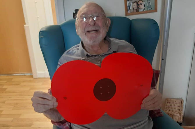 Ty Iscoed resident Harry with a giant poppy