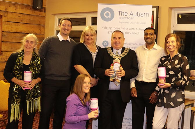 Caerphilly town mayor Mike Prew, third from right, Autism Directory staff and supporters