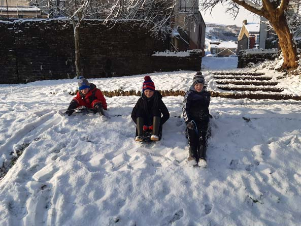 Snow sledgers in Abertridwr