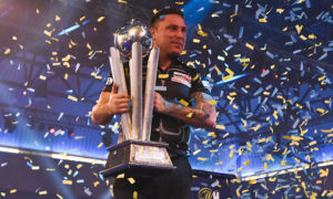 Gerwyn Price lifts the Sid Waddell Trophy after winning the PDC World Championships