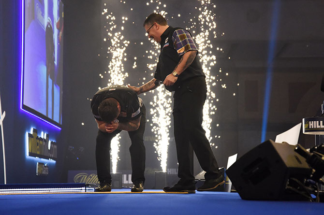 Gary Anderson congratulates an emotional Gerwyn Price after the World Championship final