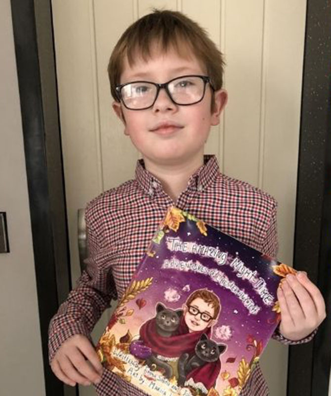 Eight-year-old Joseph Smith poses with the book he wrote