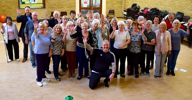Members of Rhymney Fitness Association celebrate their successful grant bid. Photo taken before pandemic