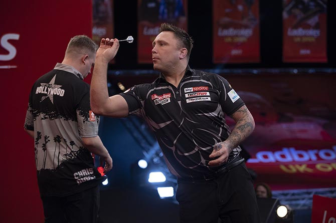 Gerwyn Price in action against Chris Dobey in the UK Open