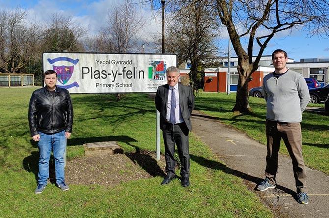 Cllr Shayne Cook, left, Plasyfelin headteacher Mark Jones, centre, and Cllr Jamie Pritchard