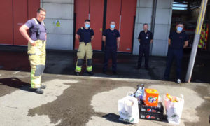 Firefighters receiving gifts from residents at Caerphilly Fire Station