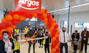 Boxer Kody Davies cuts the ribbon to open the new Argos store at Sainsburys Pontllanfraith