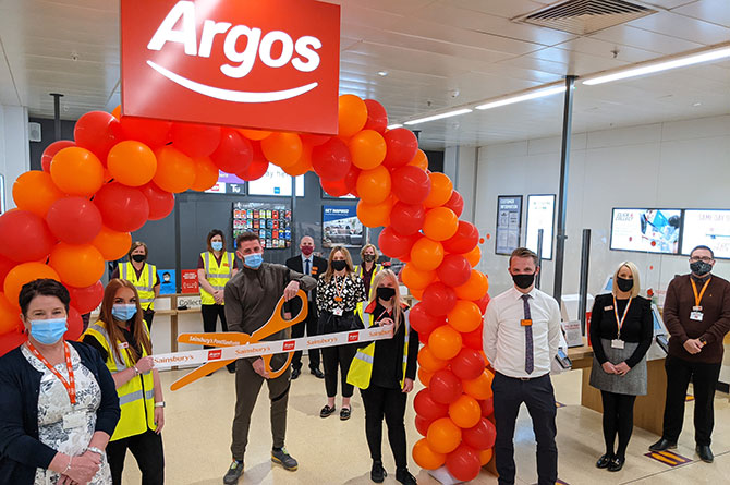 Boxer Kody Davies cuts the ribbon to open the new Argos store at Sainsburys Pontllanfraith
