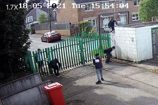 A group of children were pictured climbing over the gate to get into the ground on the day the vandalism occurred