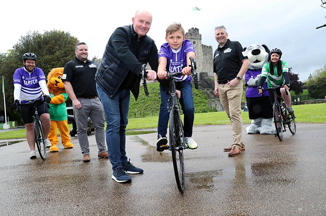 From left: Matt Evans; Velindre mascot Lomu; cyclist Gareth Williams; former Welsh rugby captain Martyn Williams; Hywel Evans; Nick Robbins; LATCH mascot Patch and cyclist Ellie Jones