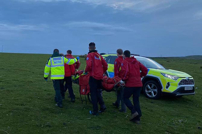A paraglider was taken to hospital after crashing on Gelligaer Common