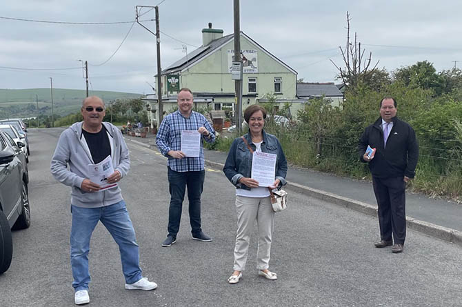 From left: Cllr David Harse, Cllr Carl Cuss, Dawn Bowden MS and Gerald Jones MP at a street surgery in Princetown