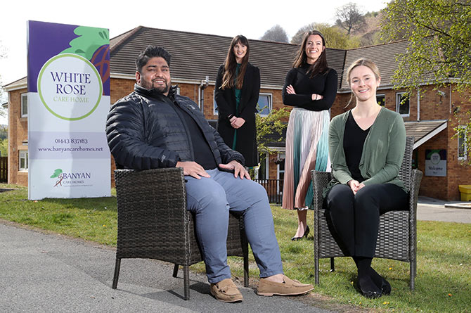 Banyan Care Homes directors Shah Seehootoorah and Nicky Seehootoorah, in the front, with Emily Jones, back left,  and Ruby Harcombe from the Development Bank of Wales