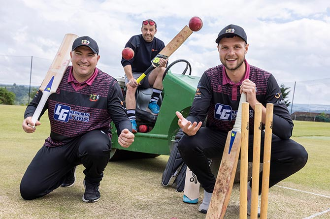 Blackwood Town Cricket Club players Dan Wilkinson, left, Owain Cooper, right, and Dai Rees of Wales and West Utilities