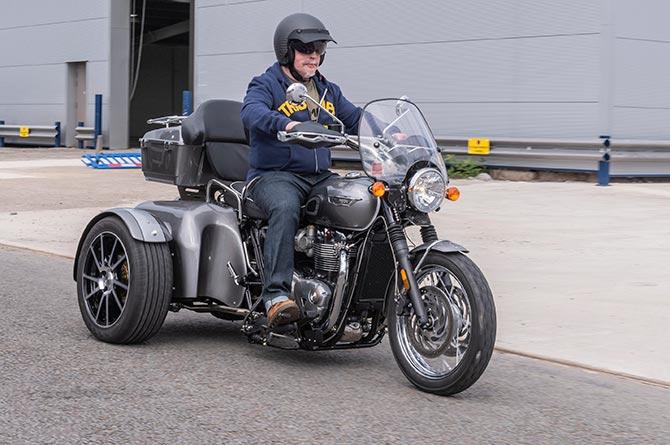 Falklands veteran Simon Weston tries out his new Triumph trike