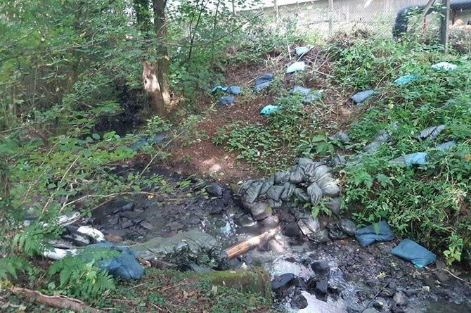 Sandbags placed in the Nant Cylla to protect from pollution have been vandalised
