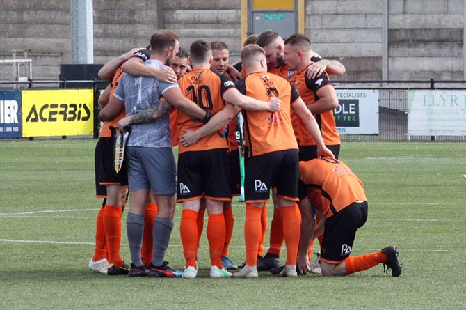 Aber Valley players huddle during their Welsh Cup tie at Aberystwyth