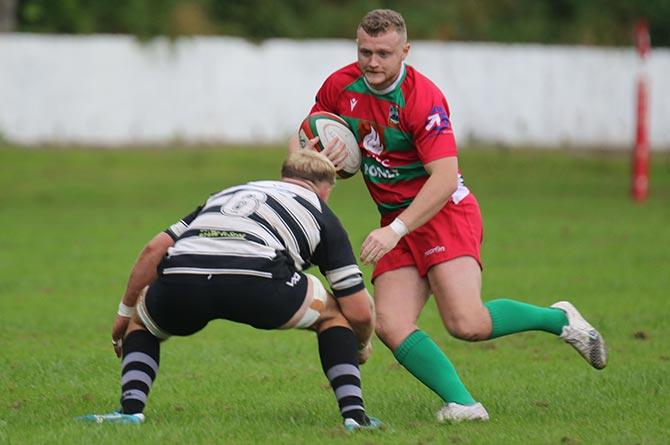 Bedwas' Sam Davies takes on a Cross Keys defender