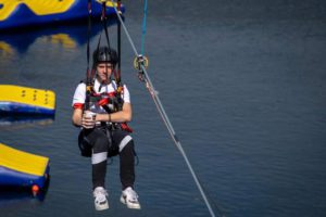Finlay Williams on the zipwire holding a cup of tea