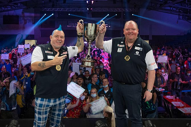 Peter Wright, left, and John Henderson, right, knocked Wales out of the World Cup of Darts