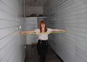 Debra Bisley, of Paul Fosh Auctions, measures the store