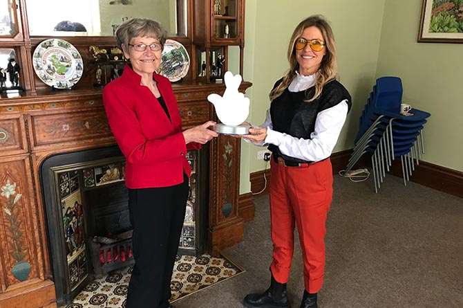Katherine Hughes, secretary of Caerphilly Miners' Centre, is presented with a National Lottery award by singer Cerys Matthews